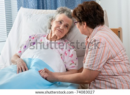 Senior female is being visited by the daughter in hospital - stock photo