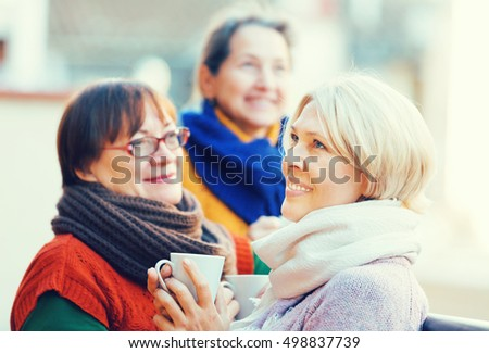 Senior female pensioners relaxing with cup of coffee on a balcony