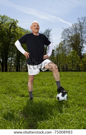 Senior football player in the park