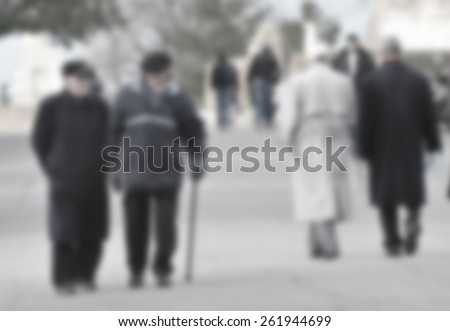 senior friends walking in park - stock photo