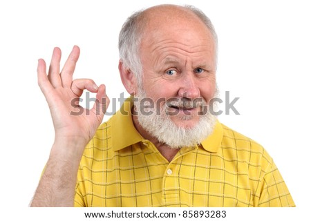 senior funny bald man in yellow t-shirt is shows gestures and grimaces - stock photo