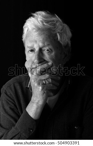 senior gentleman age 78 with visible hearing aid.
