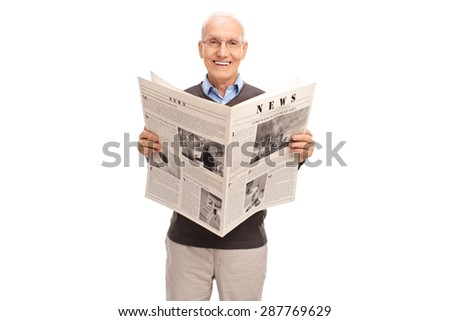 Senior gentleman holding a newspaper. The newspaper is custom made, the text is Latin and the pictures are my copyright. You can find them and the necessary Model Releases attached to the photograph. - stock photo