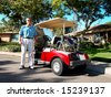 Senior Golfer And Golf Cart - stock photo