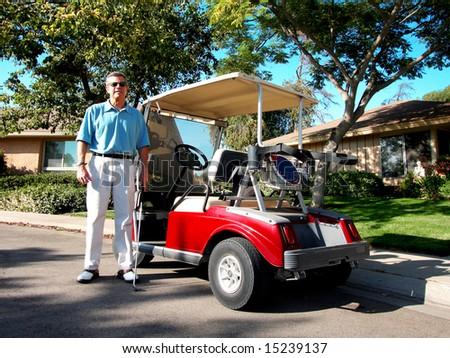 Senior Golfer And Golf Cart - stock photo