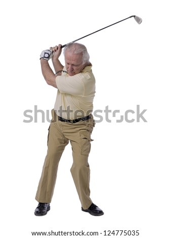 Senior golfer man hitting golf ball stock photo - stock photo