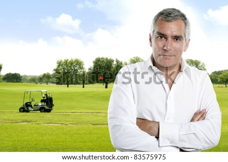 senior golfer man portrait in green course outdoor with cart background [Photo Illustration] - stock photo