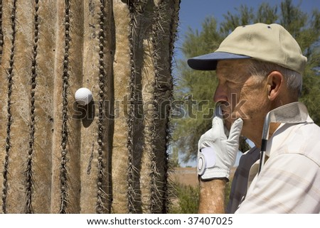 Senior golfer pondering a bad lie on a summer day in the Southwest USA. - stock photo