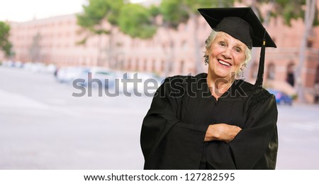 Senior Graduate Woman With Hands Folded, Outdoors - stock photo