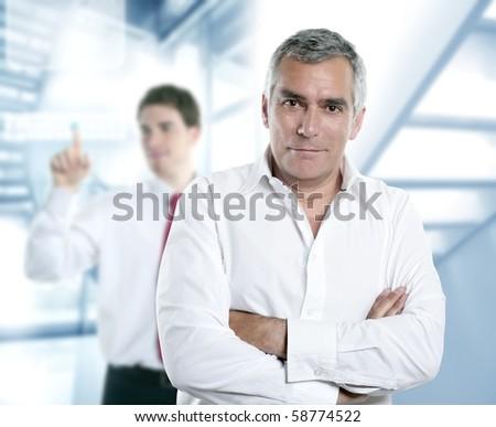 senior gray hair manager in hi-tech modern white office [Photo Illustration] - stock photo