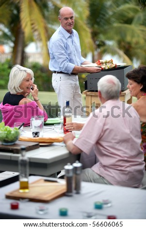 Senior group having a barbecue - stock photo