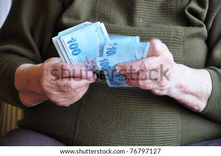 senior hands counting money