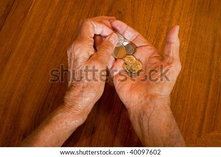senior hands holding medications - stock photo