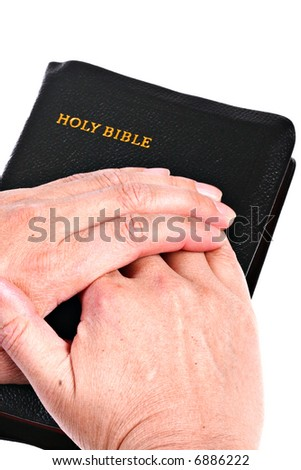 Senior Hands over Bible Close-up - stock photo