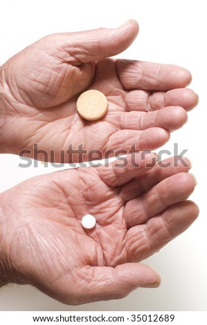 Senior hands with tablets - stock photo