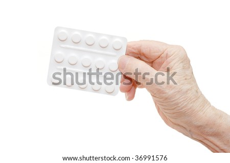 Senior hands with tablets isolated on white - stock photo