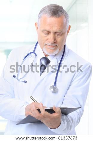 senior handsome man doctor - stock photo