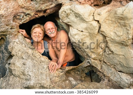 Senior happy couple having fun at the entrance of Kayangan Cave in Coron - Adventure travel in Philippines and asian destinations - Concept of active elderly around the world with no age limitation - stock photo