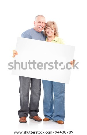 Senior happy couple with placard. Over white background. - stock photo