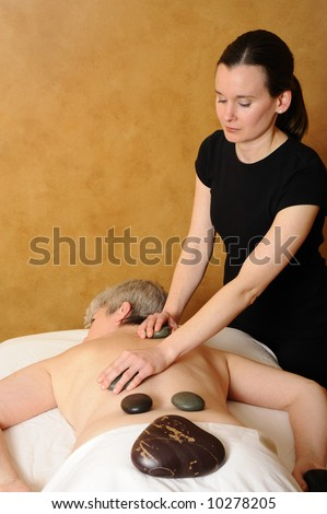 Senior Health and Fitness Hot Mineral Stone Massage - stock photo