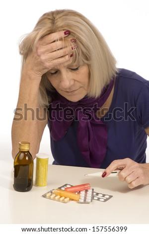 Senior health and medicine-woman having migraine - stock photo