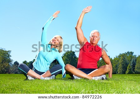 Senior healthy fitness couple. In the park. - stock photo