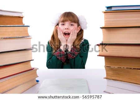 Senior high school student in uniform is sitting on the stack of book and study up. Young and beautiful schoolgirl  is wearing a traditional uniform is shocked by something. - stock photo