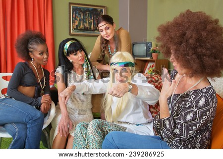 Senior hippie with mature group of friends gesturing - stock photo