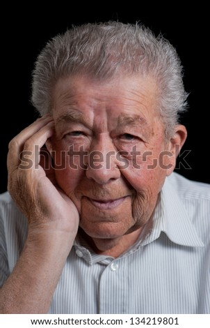 Senior holding his cheek because of toothache - stock photo
