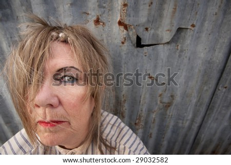 Senior homeless woman with too much makeup - stock photo