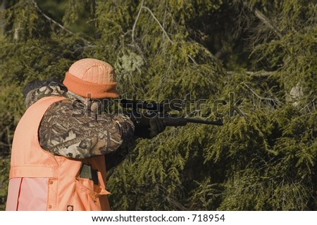 Senior hunter aiming a deer in his sight, Quebec, Canada - stock photo