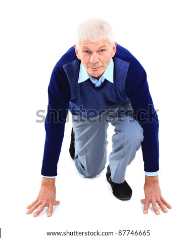 senior in pose of low start over white background - stock photo