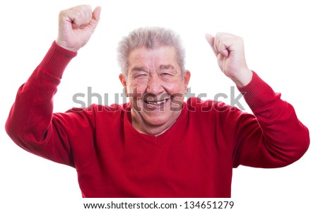 Senior is happy and raises his arms - stock photo