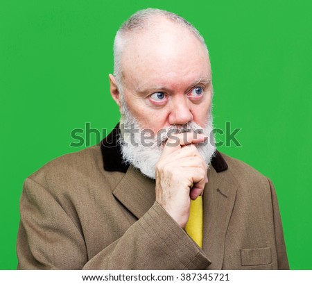 Senior is posing on green background, color and contrast manipulated - stock photo