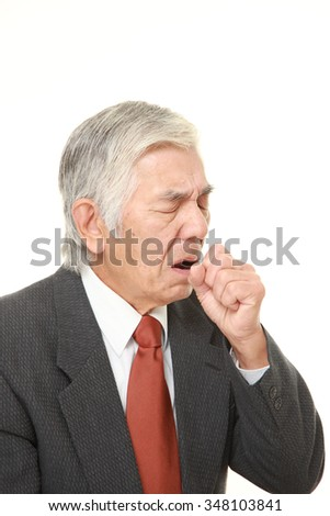 senior Japanese businessman coughing