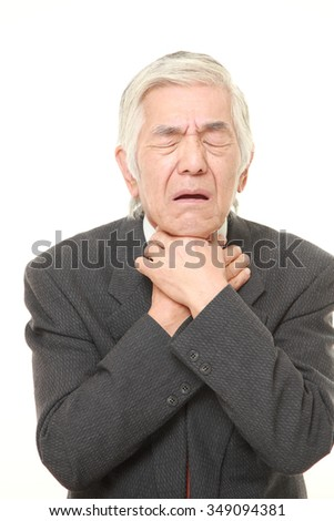 senior Japanese businessman having throat pain