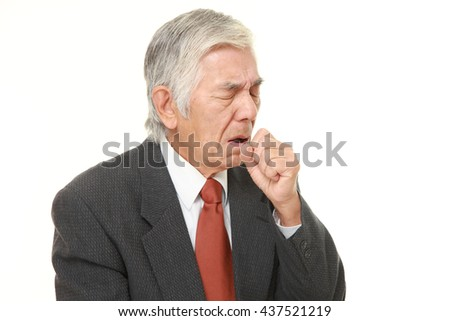 senior Japanese businessman wearing a gray suit coughing - stock photo