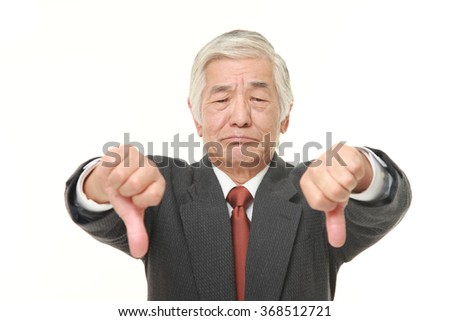senior Japanese businessman with double thumbs down gesture