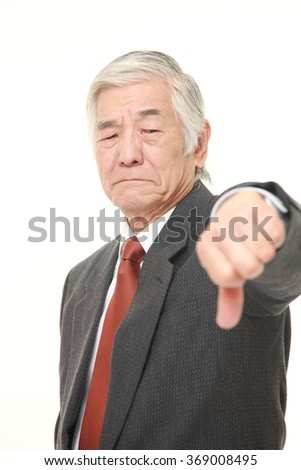 senior Japanese businessman with thumbs down gesture