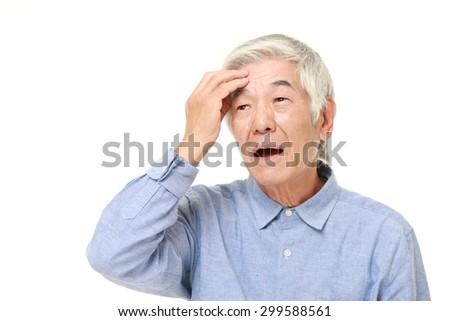 senior Japanese man has lost his memory - stock photo
