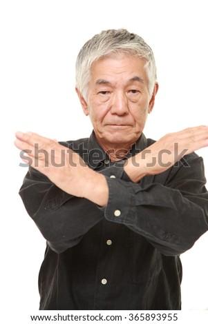 senior Japanese man making NO gesture - stock photo