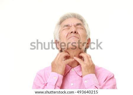 senior Japanese man scratching his neck
