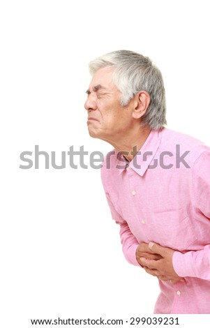senior Japanese man suffers from stomachache - stock photo