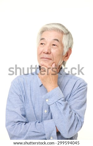 senior Japanese man thinks about something  - stock photo