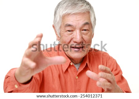 senior Japanese man with supernatural power  - stock photo