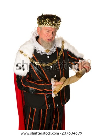 Senior king making an announcement holding a parchment scroll - stock photo