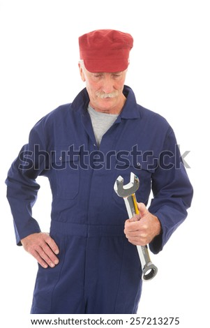 Senior laborer in blue work wear with wrench isolated over white background - stock photo