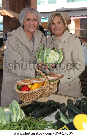senior ladies at market - stock photo