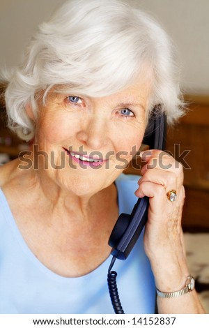Senior lady having a telephone call - stock photo