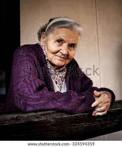 Senior lady on the porch - stock photo